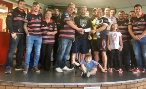 Eastmoor dragons cheque for over £1200